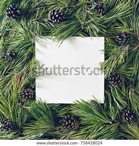 Creative background of pine branch and cones with white paper card. New Year and Merry Christmas Concept. Flat Lay. #758428024