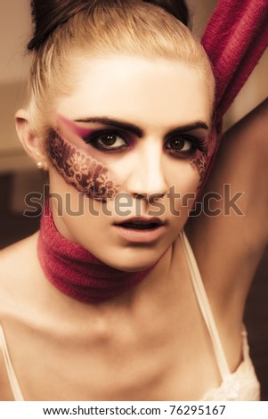 Creative Beauty Is The Face Of A Elegant Attractive Woman Staring In A Passionate Intense Gaze, Posing With A Neck Scarf In A Fashionable Glamour Face Portrait