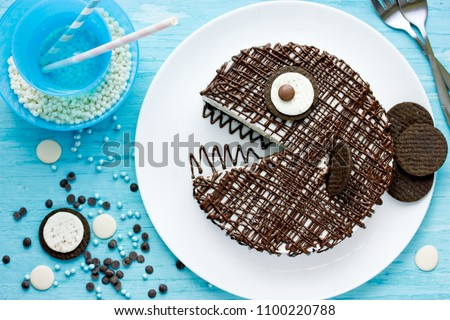 Creative birthday cake for kids, chocolate fish cake on a plate top view
