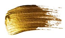 Creative brushstrokes of gold paint isolated on a white background. Gold paint texture. Smears of cosmetics, blush, highlighter, eye shadow, lipstick.
