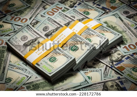 Creative business finance making money concept - background of of new 100 US dollars 2013 edition banknotes (bills) bundles close up