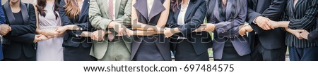 Creative business team meeting hands together in line, asian business people teamwork acquisition, brainstorm people concept. Startup friends creative people sale project panoramic banner #697484575