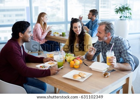 Creative business team working together on desktop pc in office Stock photo ©