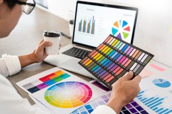 Creative businessman Graphic designer do his work at desk Consulting and business planning