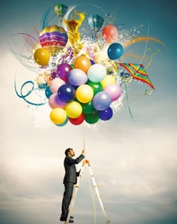 Creative businessman with colorful balloon explosion