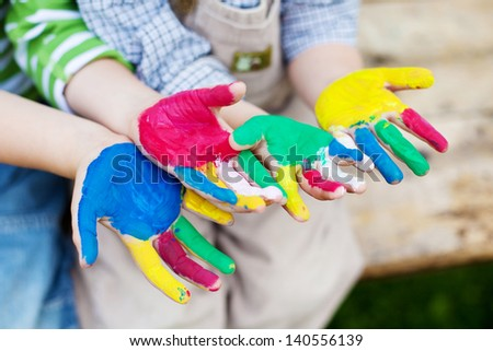 Creative children showing their colorful painted hands