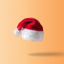 Creative Christmas background with Santa Claus hat. Minimal Christmas or New Year concept.