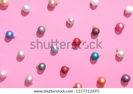 Creative Christmas baubles decoration pattern with pink background. Minimal flat lay concept.