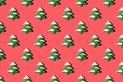 Creative Christmas pattern with fir trees on red paper background, copy space. Minimal, winter, new year concept. Top view, flat lay