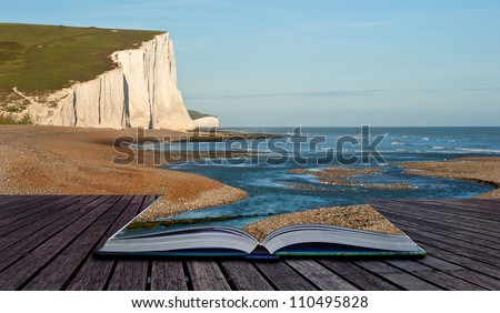 Creative composite image of seascape in pages of magic book