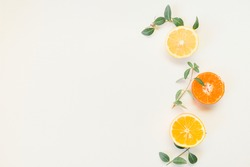 Creative composition made of citrus fruits lemon , orange with green leaf colors on white background, flat lay