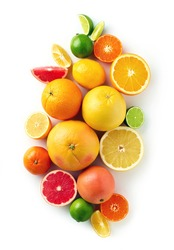 Creative composition of colorful citrus fruits isolated on white background, top view, flat lay
