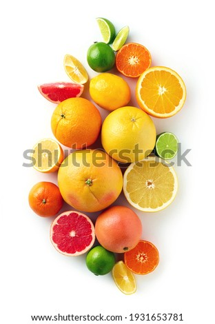 Creative composition of colorful citrus fruits isolated on white background, top view, flat lay Сток-фото ©