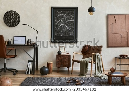 Creative composition of elegant masculine living room interior with mock up poster frame, brown armchair, industrial office desk and personal accessories. Template. Foto d'archivio ©