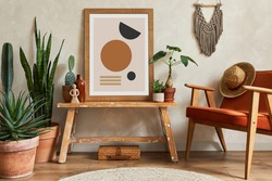 Creative composition of stylish living room interior with mock up poster frame, armchair, cacti and personal and boho accessories. Plant love and nature concept. Template.