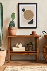 Creative composition of stylish living room interior with mock up poster frame, wooden shelf, cacti and personal accessories. Plant love and nature concept. Template.