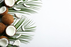 Creative composition with coconuts on white background, top view