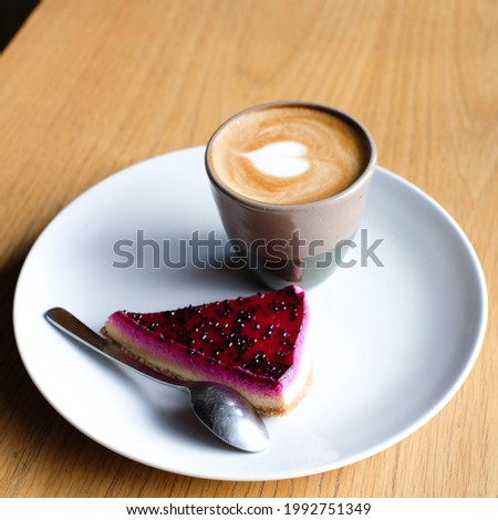 creative composition with coffee and cake in table