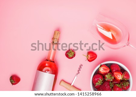 Creative composition with rose wine and delicious strawberries on the pink background, top view #1415258966