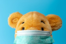 Creative composition with Yellow bear with virus mask. Minimal Corona virus outbreak. Holiday concept.