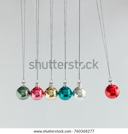 Creative concept. Colorful Christmas baubles decoration. New year minimalism.