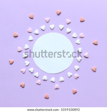 creative concept in the style of minimalism. hearts on pastel background with place for text. #1059100892