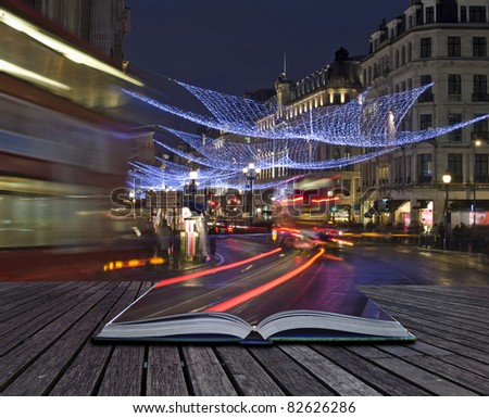 Creative concept of London Christmas lights coming out of pages in magical book