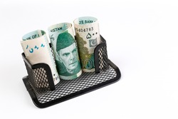 Creative concept of Pakistani currency bank note of 500 rupees rolled into card holder , isolated on white background.