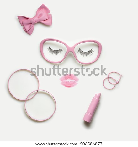 Shutterstock Creative concept photo of accessory and makeup set as a portrait of a woman on white background.