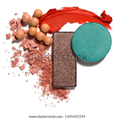 Creative concept photo of cosmetics swatches beauty products lipstick blusher balls pearls square and round eyeshadow on white background.