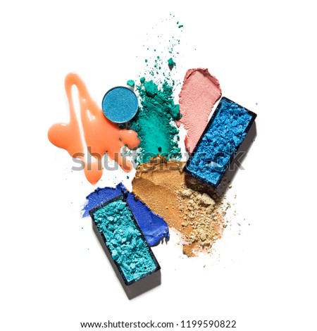 Creative concept photo of cosmetics swatches beauty products lipstick lip gloss square and round eyeshadow on white background.