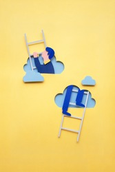 Creative concept photo of man climbing ladder made of paper on yellow background.