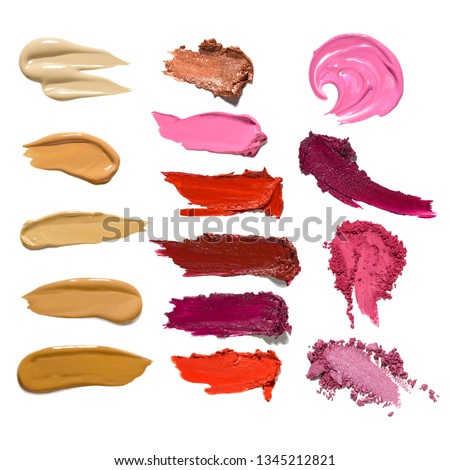 Creative concept photo set of cosmetics swatches beauty products mix lipstick lip gloss foundation cream eyeshadow on white background.