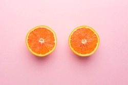 Creative Concept. Two Orange on Light Pink Pastel Background, Top View.