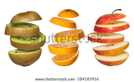Creative concept with flying fruits. Sliced orange, kiwi, apple isolated on white. Levity fruit floating in the air.