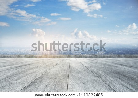 Creative concrete ground, beautiful city view and sky backdrop #1110822485