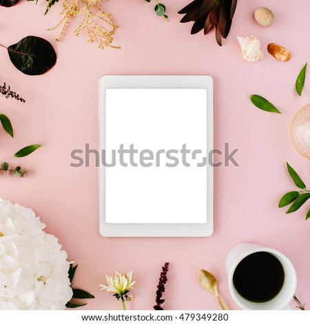 creative decorated and arranged flat lay frame concept with tablet, vintage tray, hydrangea, shells, coffee, golden spoon, branches on pink background. top view