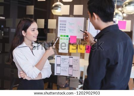 Creative designer choosing color samples for mobile responsive website development with UI/UX. Developing wireframe sketch layout design mockup on smartphone screen. #1202902903