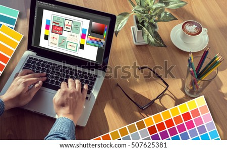 Creative Designer Graphic at work. Color swatch samples, Illustrator Graphic designer working digital tablet and computer #507625381