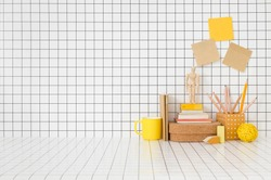 Creative desk. Table with wooden and yellow, supplies, notes, books, boxes and chequered wall.