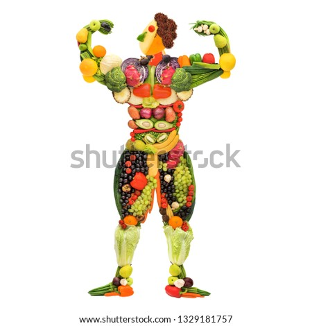 Creative diet food healthy eating concept photo of posing muscular bodybuilder made of fresh fruits and vegetables on white background.