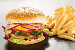 Creative diet food healthy eating concept photo of tempting tasty burger with red onion and vegs along with yummy french fries fastfood junk fat on white background.