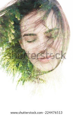 Creative double exposure portrait of woman combined with photograph of nature