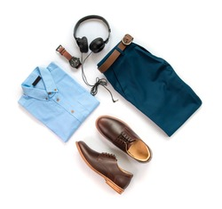 Creative fashion design for men casual clothing set with brown shoes , watch, belt, trousers, shirt and earphone isolated on a white background, Top view