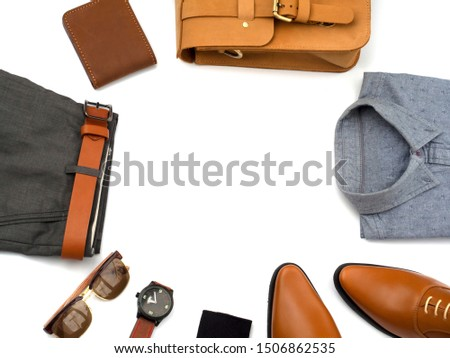 Creative fashion design outfits for men casual clothing set and accessories isolated on white background include office shoes, gray shirt, wallet, bag leather and accessory. Top view, copy space