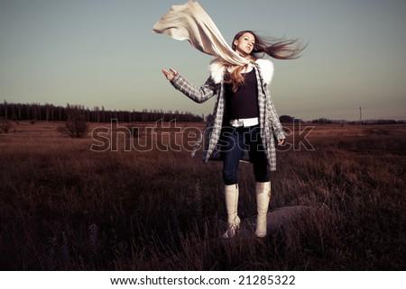 Creative fashion girl on field