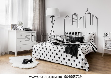 Creative female bedroom with decorative headboard wall graphic #504555739