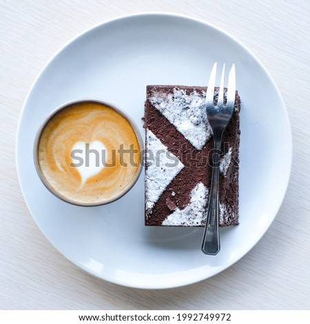 creative flat lay composition with coffee and cake