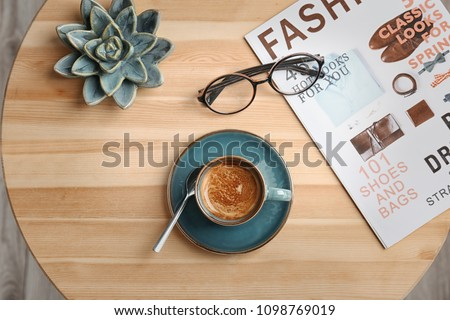 Creative flat lay composition with delicious hot coffee on table