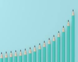 Creative flat lay design of crayons, Blue pencils on technical chart of financial expansion. wave pattern row on blue pastel background. minimal idea. business concept for control financial budget.